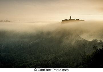 Civita di Bagnoregio in a fog. Italy