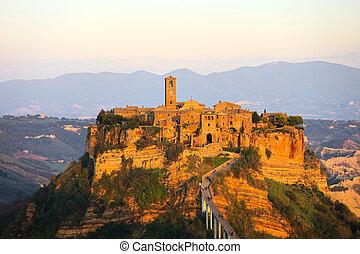 Civita di Bagnoregio landmark, aerial panoramic view on sunset.