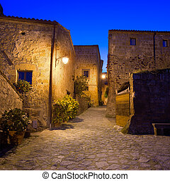 Civita di Bagnoregio ghost town landmark, medieval village view on twilight. Lazio, Italy, Europe.
