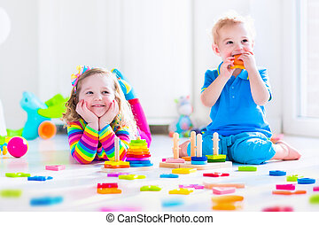 Cjildren playing with wooden toys
