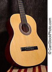 Guitarra vendimia monocromo cerca ac stico cerca for Taburete para tocar guitarra