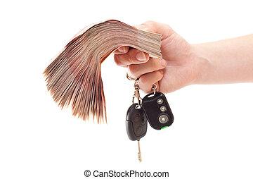 clés, paquet argent, main