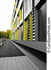 cladding on business building in grey, yellow and green