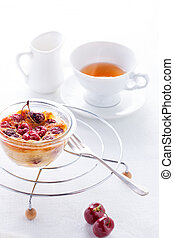 Clafoutis with berries and a cup of tea.