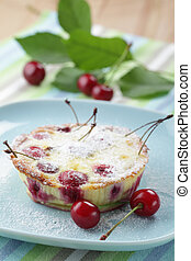 Clafoutis with sour cherry on the plate closeup