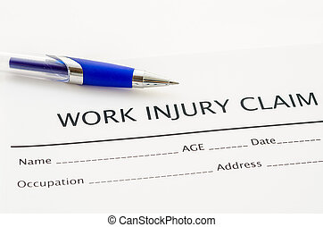 Claim form for an injury at work with pen.