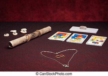 Clairvoyance equipment with weddings rings on dark desk