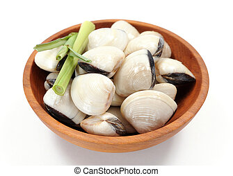 clam and lemon grass on wooden bowl