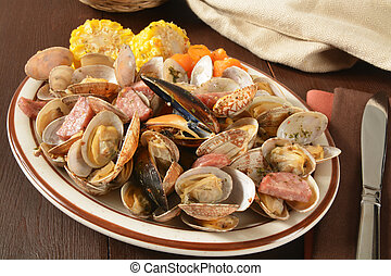 New England Style Clam Bake dinner, with corn on the cob