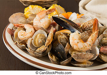 New England style clam bake with shrimp, mussels and corn on the cob