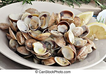 Clam dish decorated with sprig of rosemary in the background