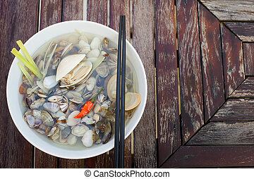 Clam soup in white bowl. Copy space. Top view.