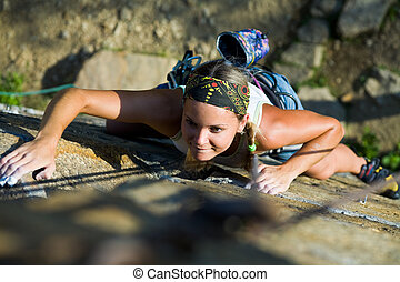 Clamber - Photo of woman heartily climbing on mountain