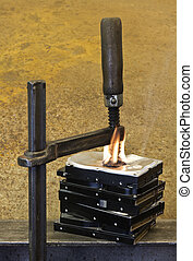 clamp pressing on burning stack of hard drives