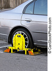 Clamp - Restricted park vehicle with yellow wheel clamp