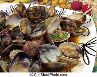 clams on garlic and paprika sauce with decoration