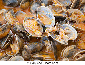 "Clams cooked in the recipe ""almejas a la marinera"" ..."