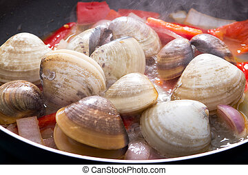 clams cooking in pan