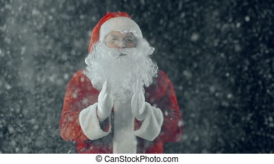Clap Your Hands - Close up of Santa Claus against black...