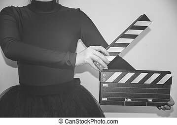 clapboard in hand
