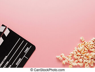 Clapboard on a pink background, movie concept
