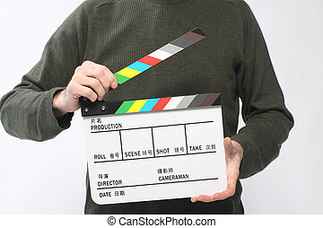 Clapboard - Man holding a movie clapboard.