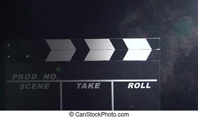 Clapper board close up. Black background - Clapper board...
