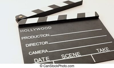 clapper for cinema with inscriptions hollywood, production,...