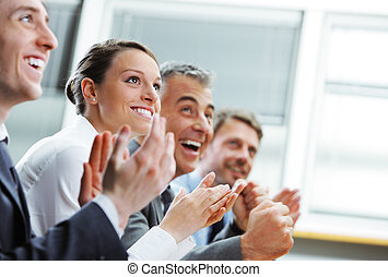 Clapping business people - Group of cheerful businesspeople...