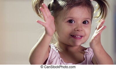 Claps - Close-up of a playful little kid clapping hands