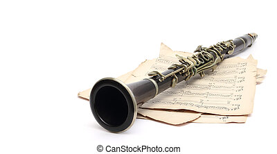 clarinet and music - an old clarinet on music sheets over...
