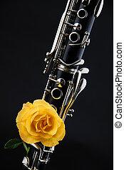 Clarinet Yellow Rose Isolated on Black - A soprano clarinet...