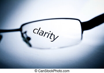 """Clarity - Word """"clarity"""" viewed from a glasses."""