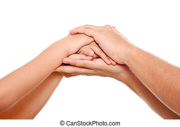 Clasped hands - Hands of parents and children together in a...