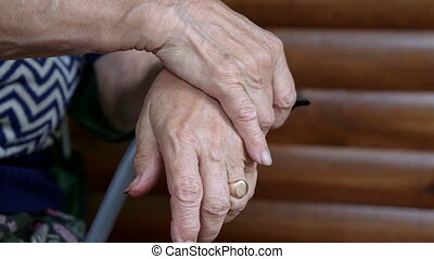 Clasped senior woman hands