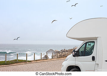 Class B Motorhome RV and the Scenic Sea. Road Trip Camping. Recreation Vehicle Theme.