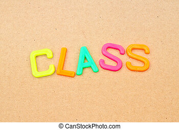 Class in colorful toy letters on paper background