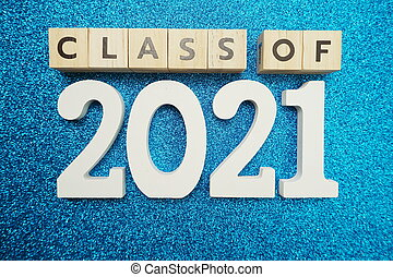 Class of 2021 word alphabet letters on blue glitter background
