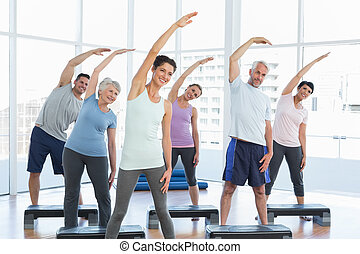 Class stretching hands in yoga class - Portrait of fitness...