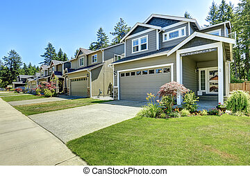Classic american house exterior with garage and driveway
