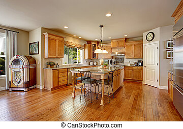 Classic American kitchen inerior with brown cabinets and...