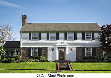 Classic American suburban house with blue sky background