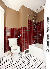 Classic antique brown and red bathroom with white toilet and red tiles.