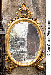 Classic antique mirror with gilded frame