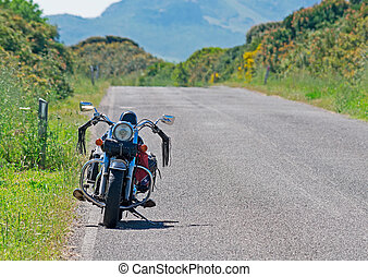 motorcycle parked in a country road