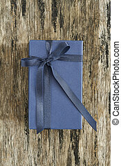 Classic blank navy blue gift box on wood plate
