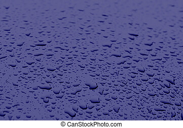 Classic blue color 2020. Texture of water drops on metal. Classic blue background, blue toning 19 4052. Abstract trendy background, mock up with copy space for text