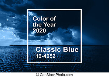 Classic Blue pantone color of the Year 2020. dramatic sky with clouds and sun rays over river in summer cloudy