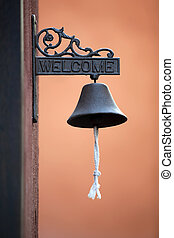 Classic Brass Door Bell with Orange Wall background