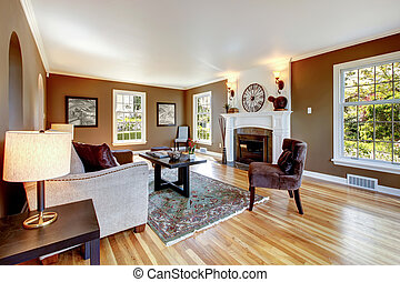 Classic brown and white living room with hardwood floor.